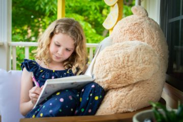 A girl reading about Rosh Hashanah
